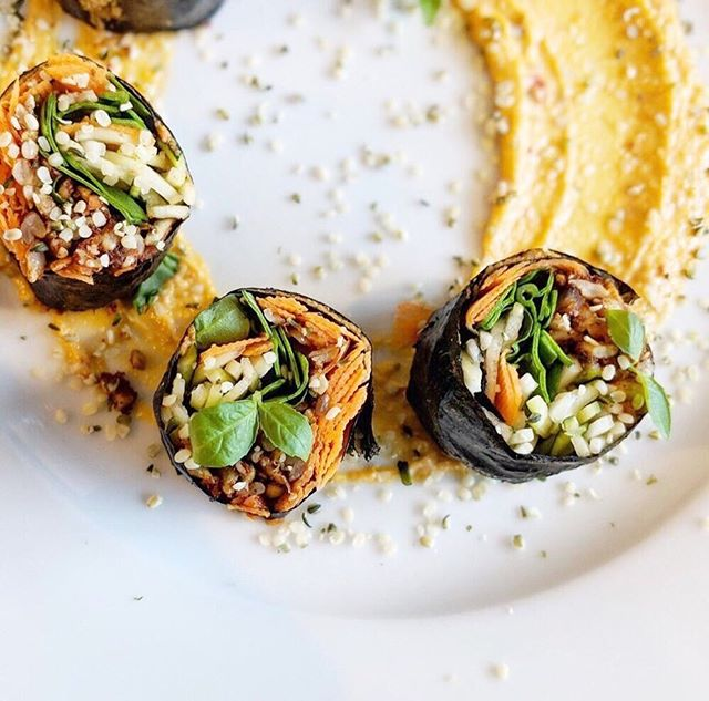 Okay - the next batch up can be a day in Kensington and area if you would like to do a food tour like many of you suggested after the last few posts 😂🤗.. @raweateryandmarket recently launched a new menu and for the week they will be featuring their 'Raw Sushi' with marinated sunflower seed pate, cucumber, avocado, carrots and pepper rolled in nori and accompanied by a fermented sriracha tahini sauce. For some afternoon grazing you can then head to @winebarkensi to enjoy a vegan 'Cheese + Charcuterie' board with pickled vegetables and candied pecans! Then you can just walk up the stairs to @the_brasskens to try their charred carrot and raisin tart with toasted coconut and cantaloupe salad (not pictured). Then (yes we are still going) you can stroll along the river to @rivercafeyyc to try their dish of fire morels and ash baked potato with fried potato skin broth, hakurei turnip and caramelized onion. Does this sound like the most magical day or what?! 🍙🥕🍴😋🌱 #yycveganweek #yycgoesvegan . . . . . . . #yyc #yycliving #yycevents #yycfoodie #vegan #vegansofig #vegansofinstagram #vegansofcanada #govegan #veganfood #veganfoodshare #veganlifestyle #veganliving #bestofvegan #vegancommunity