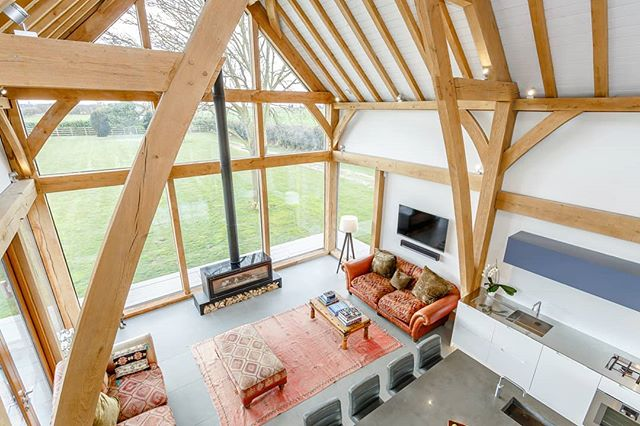 View from the gallery of this new country home!  #cambridgeshire #countryliving #openplan #oakframe @carpenter_oak #timberframehouse #woodburningstove #kitchen  #woodburner #contemporary #modern #house #design #livingroom #interiordesign #sittingroom #fireplace #oakframing #sustainable #builder @dbsharpandsons #architect #roderickjames #roderickjamesarchitects