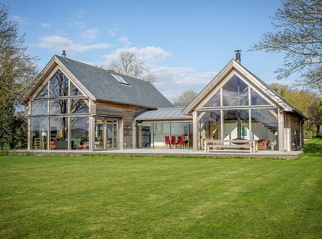 This new country home is the ideal mix of traditional construction techniques and modern-day comfort. #cambridgeshire #countryliving #glazedgable #fixedglazing #openplan#oakframe@carpenter_oak #glazing #glasswall #timberframehouse#woodburningstove #woodburner#contemporary#modern#house #design#external #oakframing#sustainable #builder @dbsharpandsons #architect#roderickjames #roderickjamesarchitects