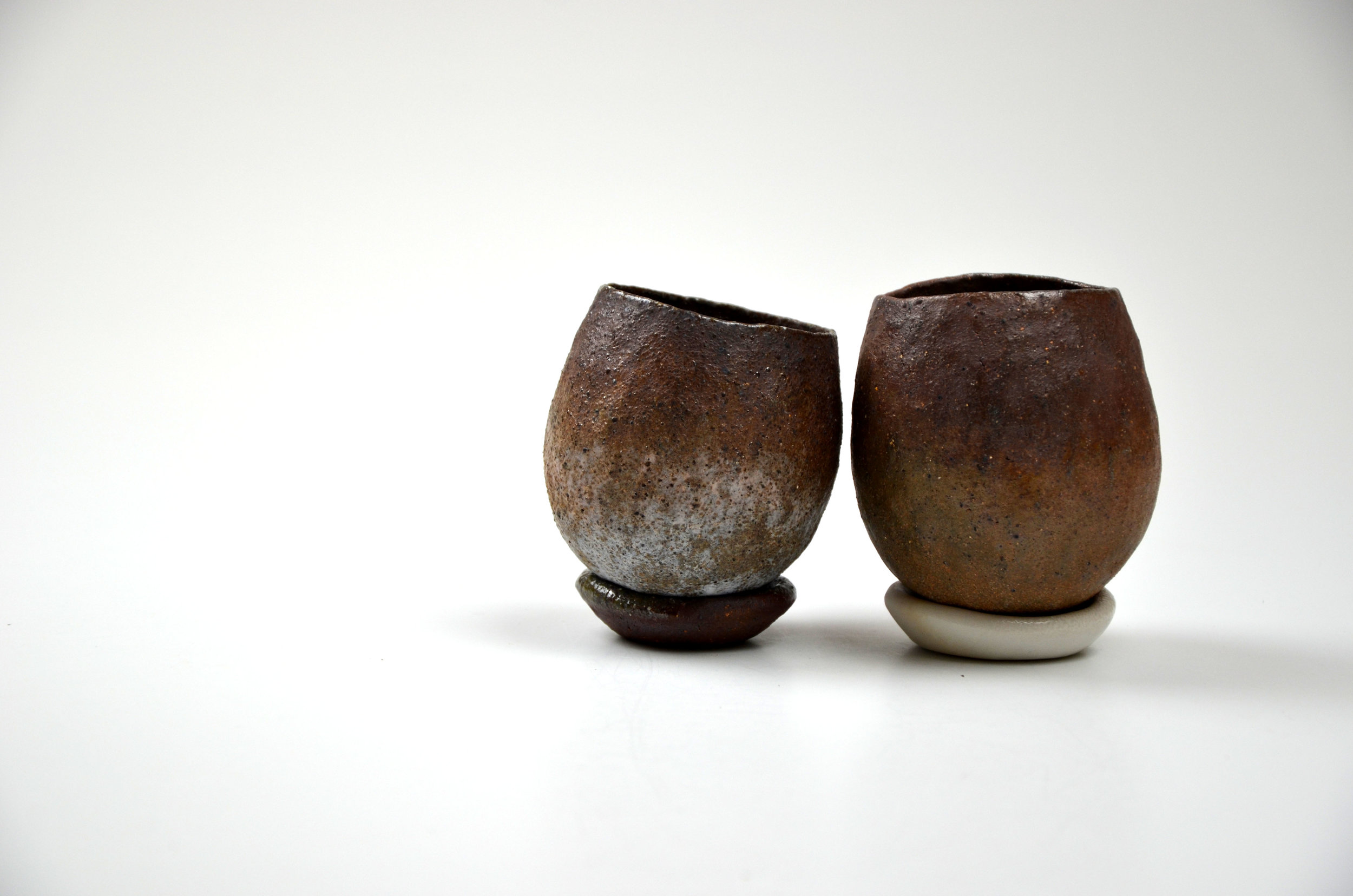 Two comfort cups with worry stones.jpg