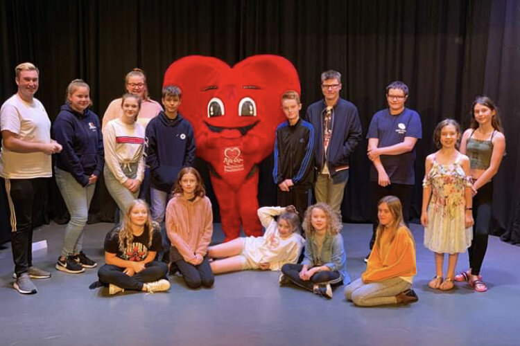 The Young Players present a cheque to the British Heart Foundation raised from the raffle held during performances of 'Annie'.