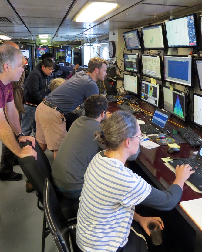 Intense concentration in the control room during the first dredge.