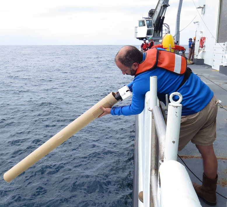 Stephen, one of our marine technicians, launching an expendable XBT to measure water temperature