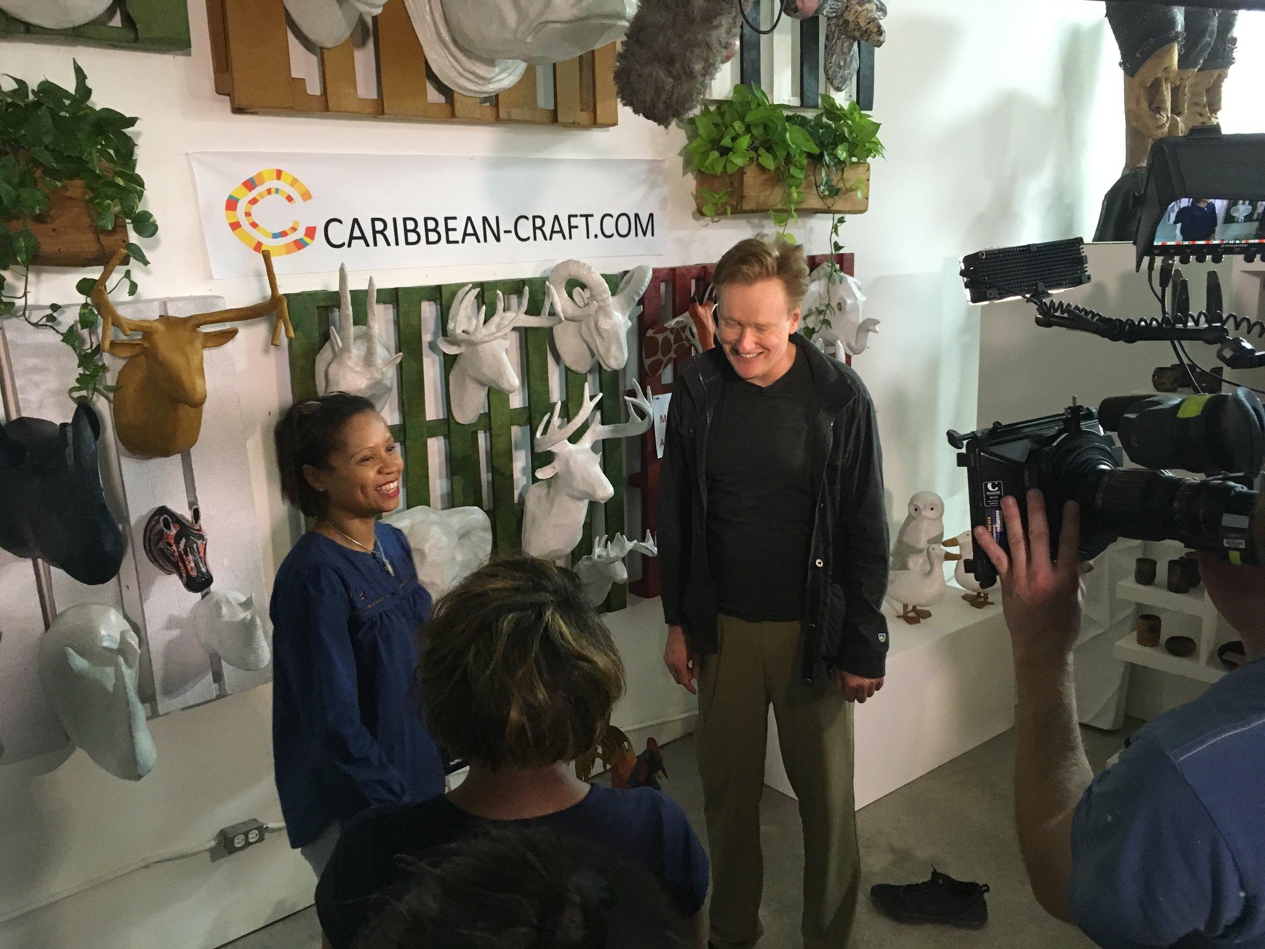 Conan O Brien with Magalie during his visit in Haiti.JPG