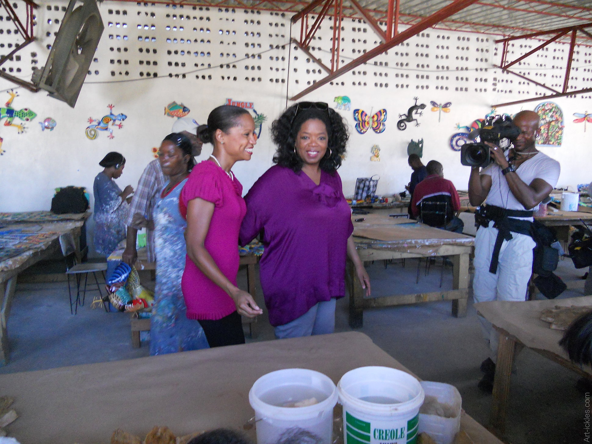 Oprah Winfrey touring Caribbean Craft with Magalie Noel Dresse in 2012 for her Tv show.