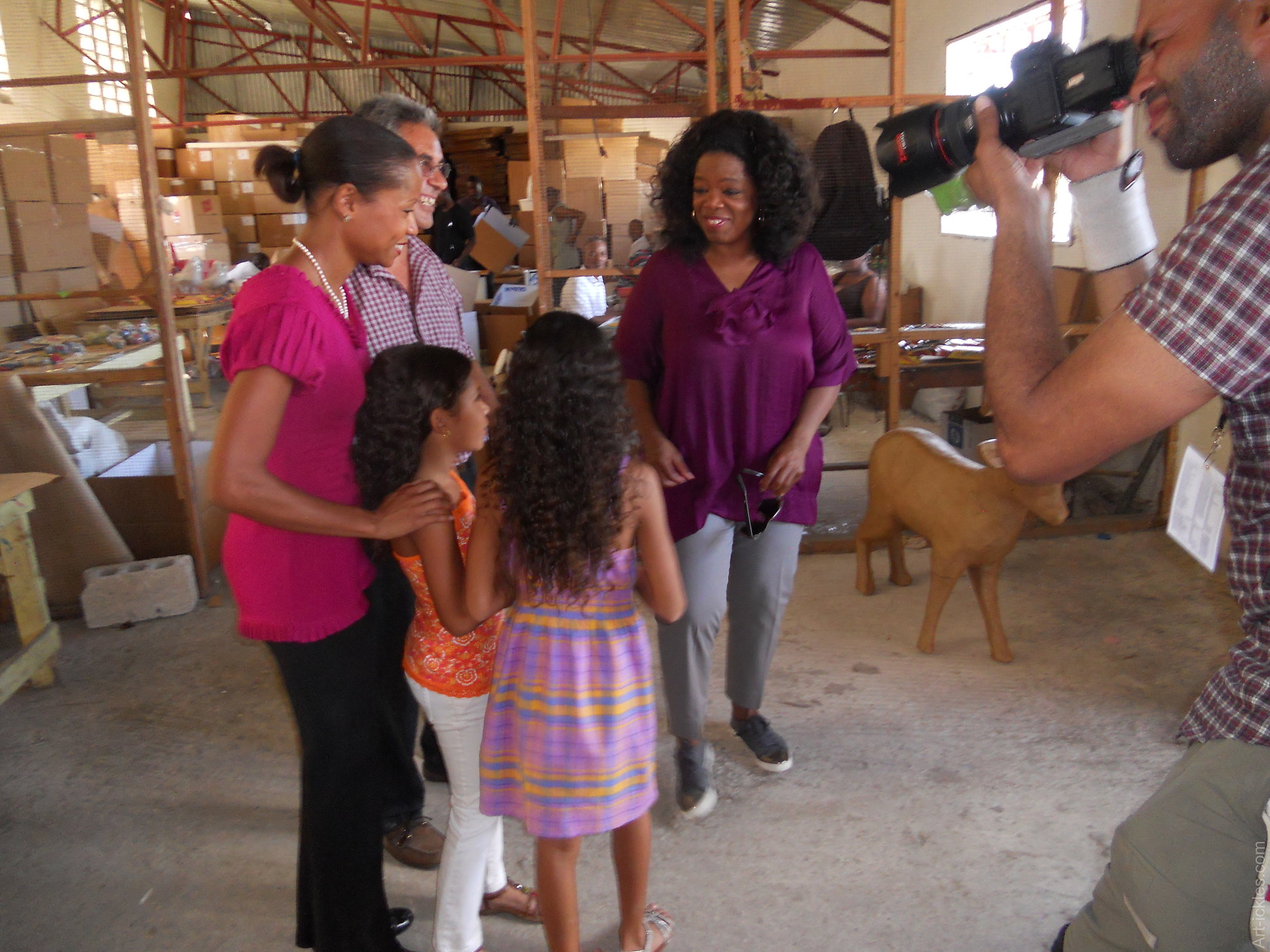 Oprah Winfrey being introduced to Magalie's And Joel Dresse's daughters, Kiana and Leah.