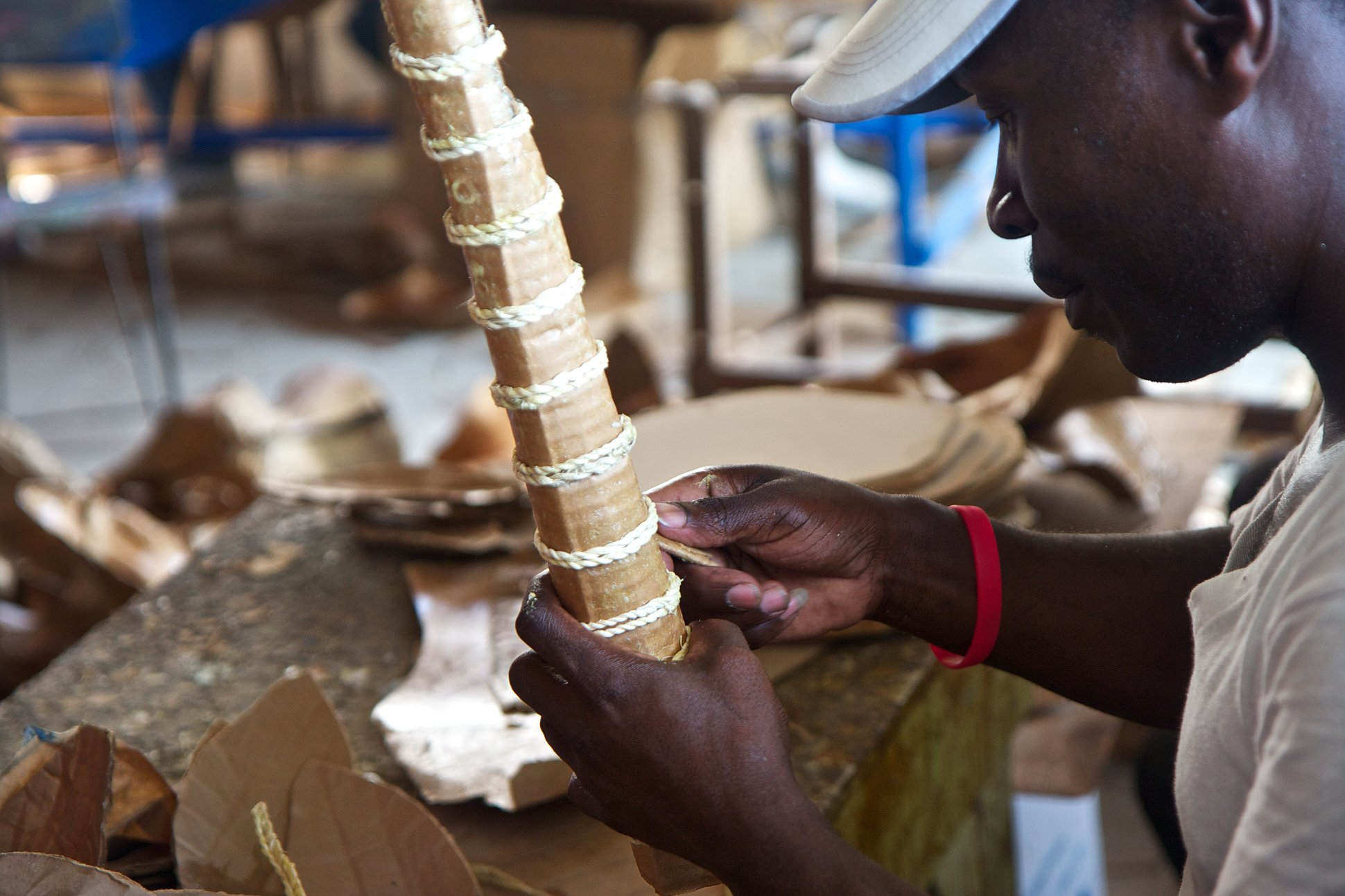 Jean, an artisan of Caribbean Craft, is adjusting the sisal cords used in the horns of the paper mache Impala. Picture by Nadia Todres
