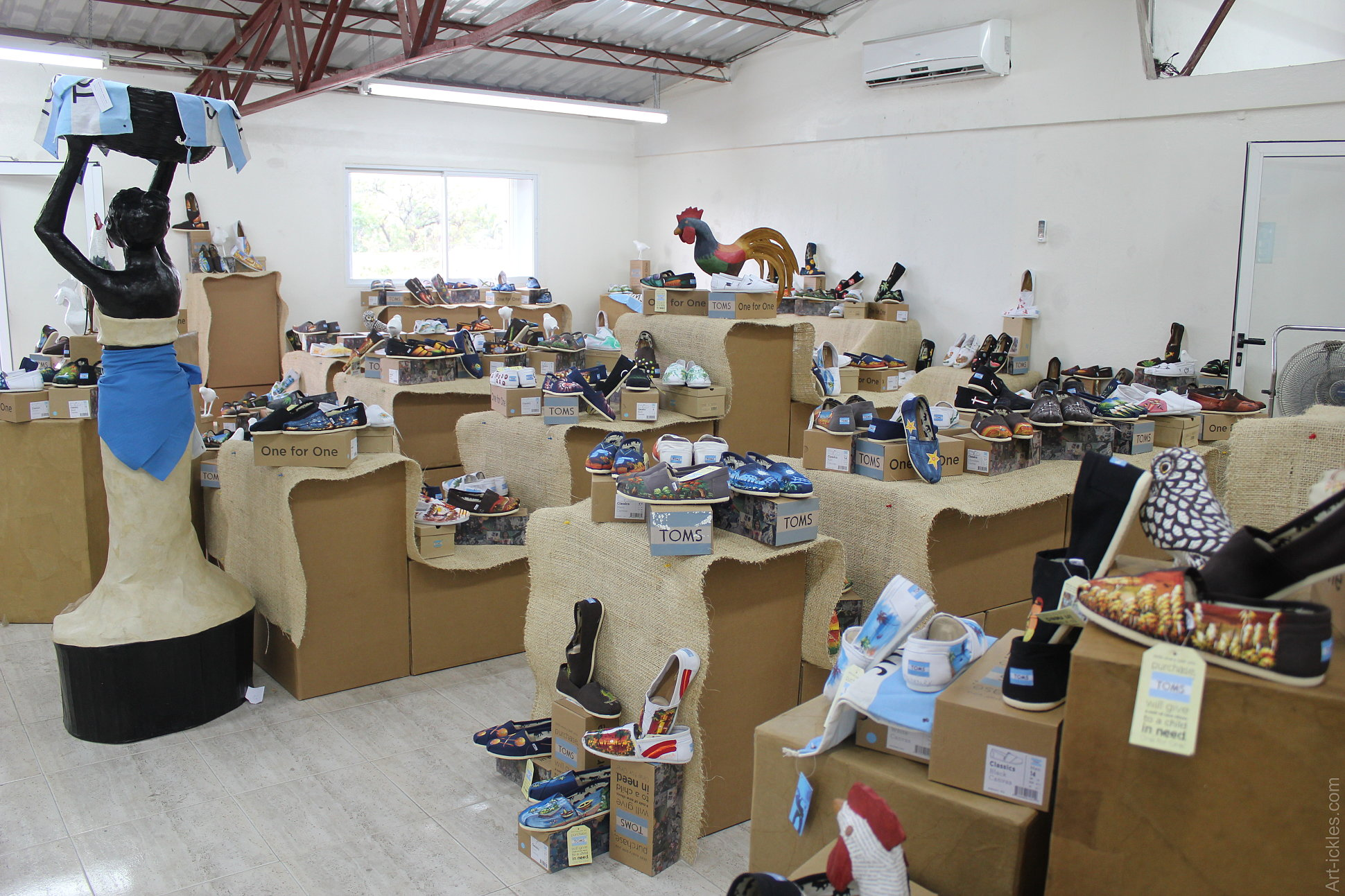 Preparing the TOMS shoes display for their CEO's visit in Haiti. Mixture of paper mache items and painted shoes.