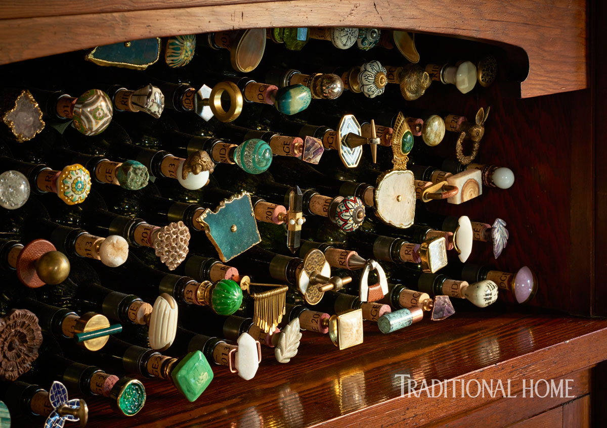 The designer attached knob hardware to corks to create the dazzling wine-stopper display.
