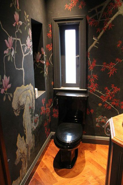 The Powder Room: Before  This powder room had a dark and moody pre-makeover look with intense wallpaper and black furnishings.