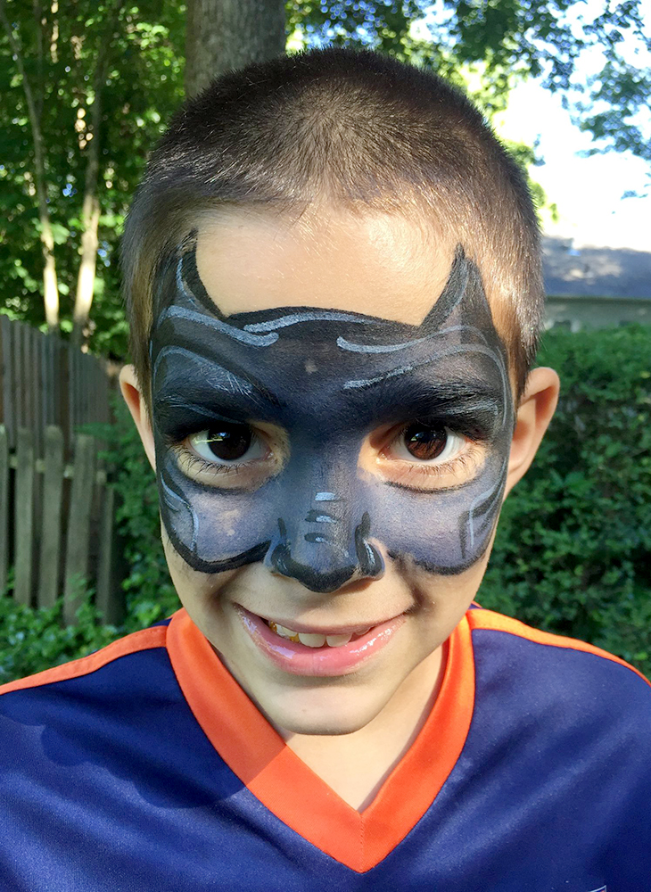 Young boy outside with face painted