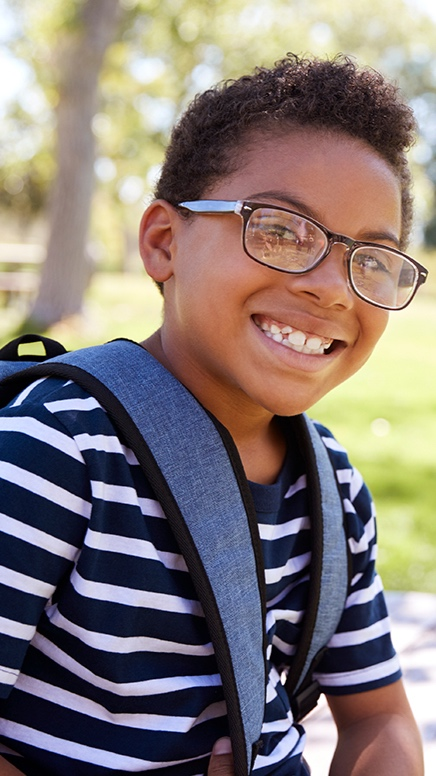 A young boy with backpack