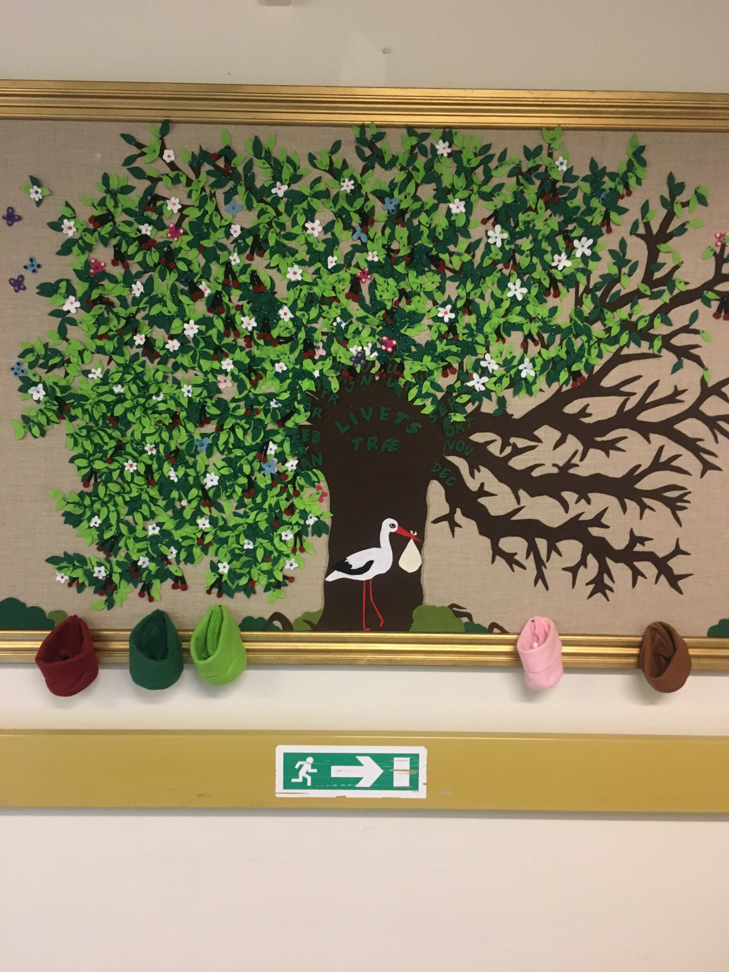 Pinboard in the birthing department. Every leaf represents a newborn child. For midwives, taking care of mothers babies are the number one priority. Everthing else is secondary.