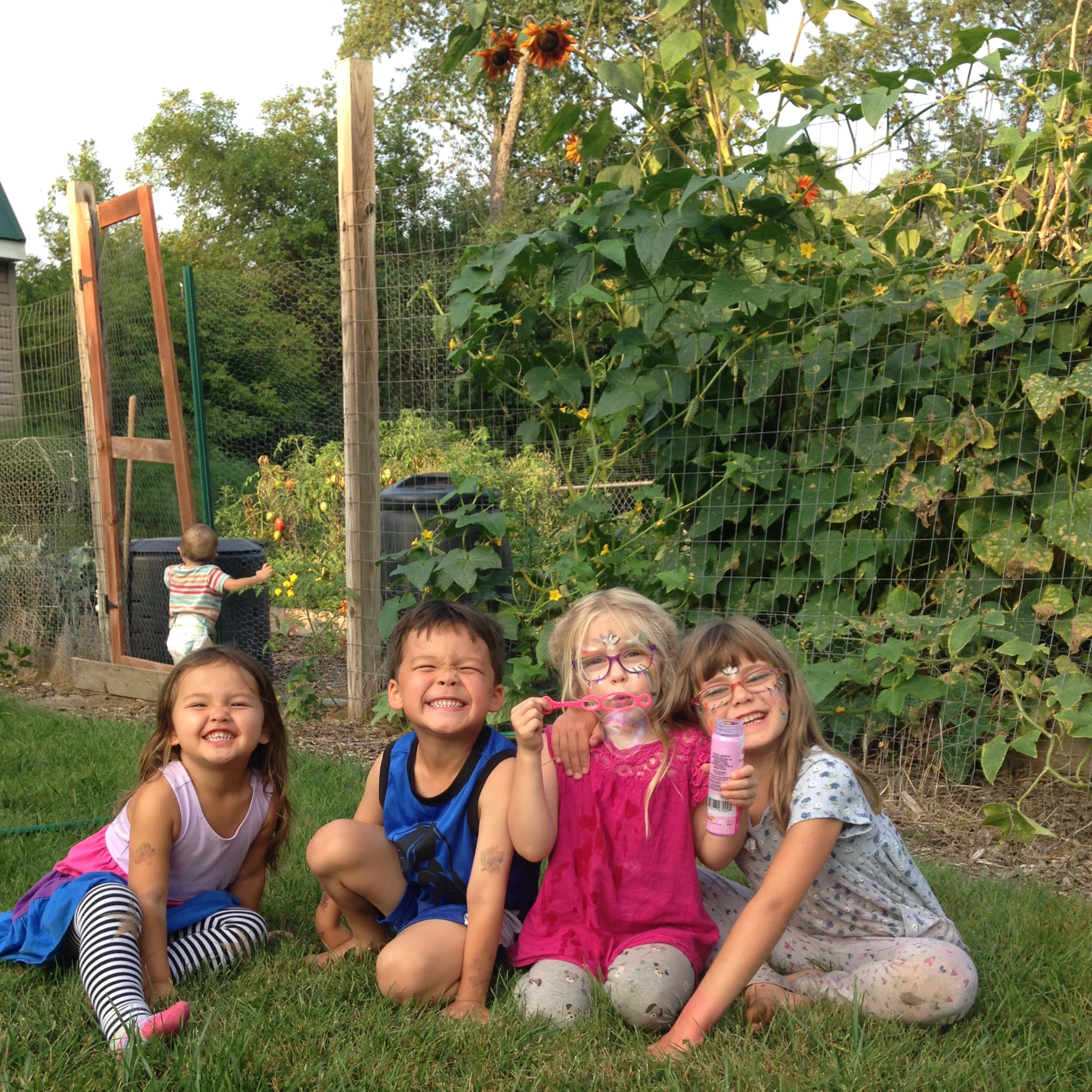 Our kids with friends in front of our garden. The little one was too busy for a picture - had his eye on some cherry tomatoes!