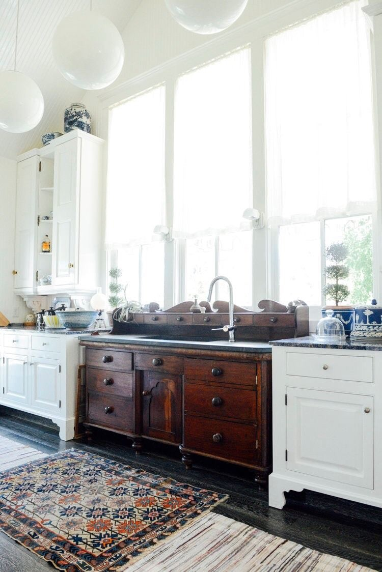 Antique chest is now a part of new kitchen repurposed as sink cabinet so clever!
