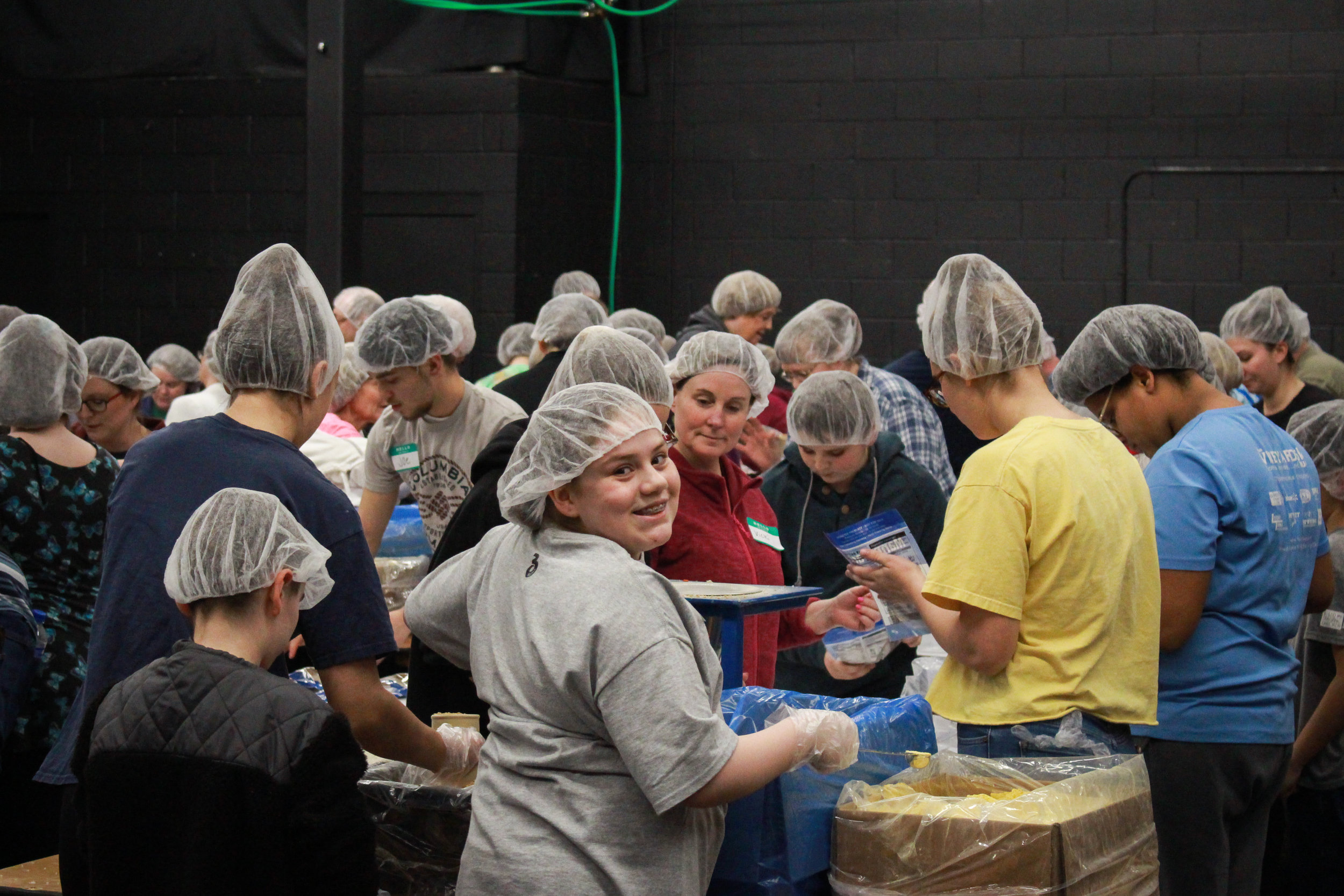 Volunteers at Vineyard Church's meal-packing event
