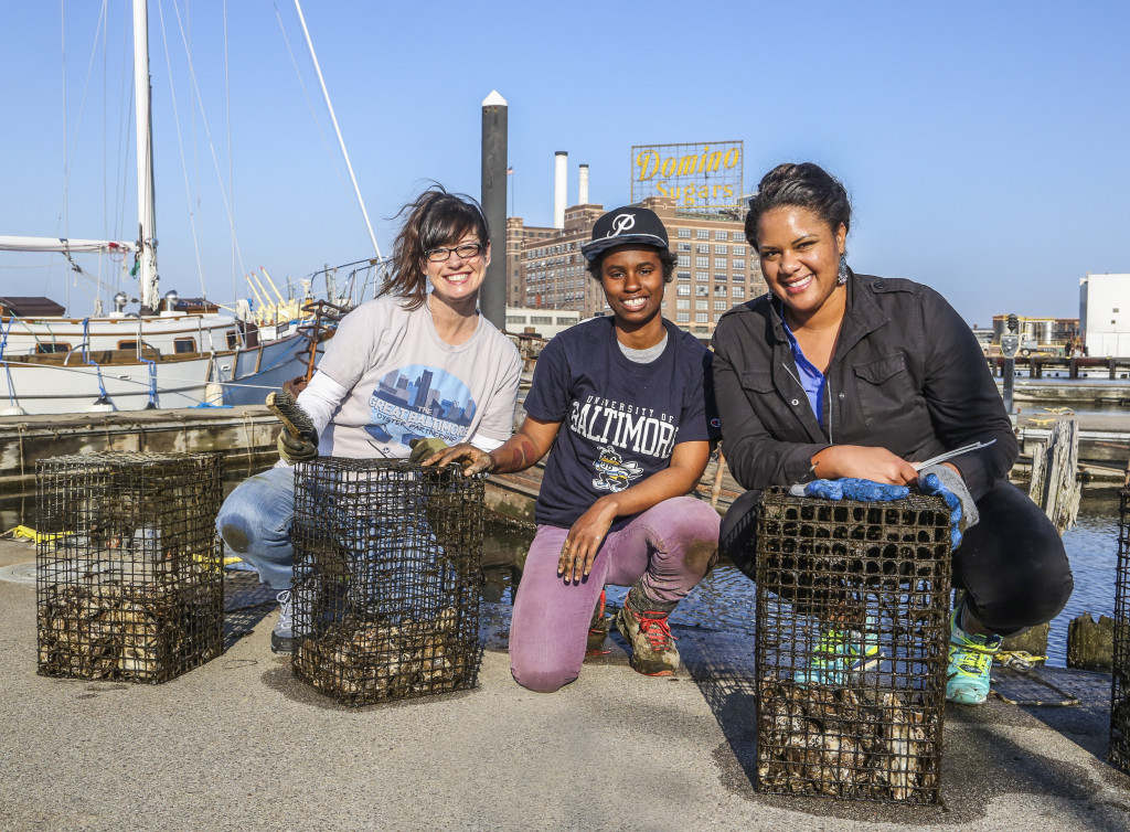 Tammy Dexter, Lanae Jackson and Carmera Thomas clean oyster cages.  Photo from Baltimore Style magazine.