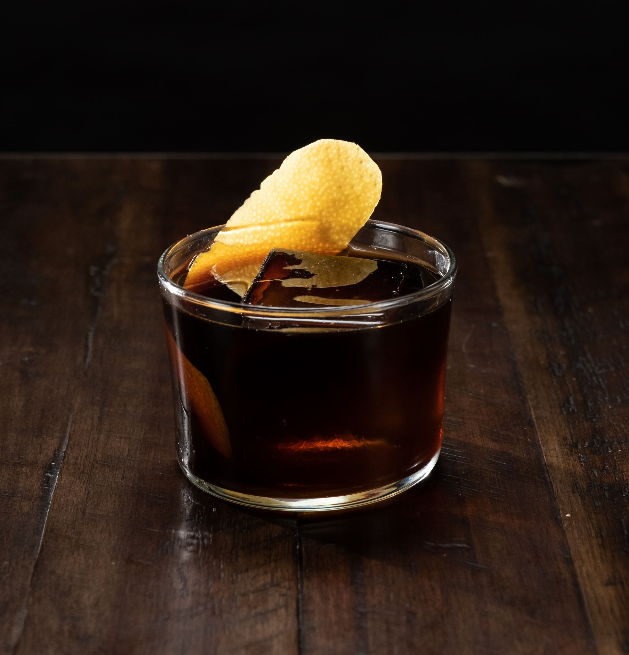 Whiskey + bitters + sugar + orange