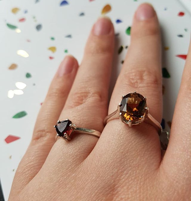 I got some new rings in and AAHHH I am tempted to keep them!!!! The trillion garnet matches a pair of studs that are available. And the champagne topaz just catches every little bit of light so brilliantly.  I've also got a couple of other rings waiting in the wings, you'll see them soon too! . . . #jewelry #garnet #silver #ring #engagementring #finejewelry #kelseyprudhommefinejewelry #topaz #champagne #🍾💎 #sparkly #smallbusiness #linkinbio #etsy