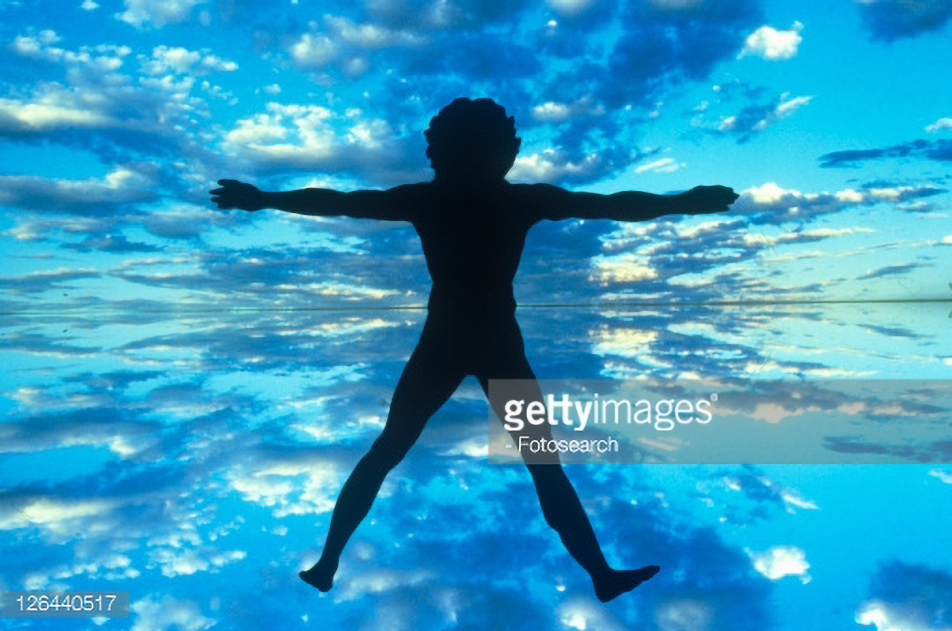 126440517-clouds-and-blue-sky-behind-silhouette-of-new-gettyimages.jpg