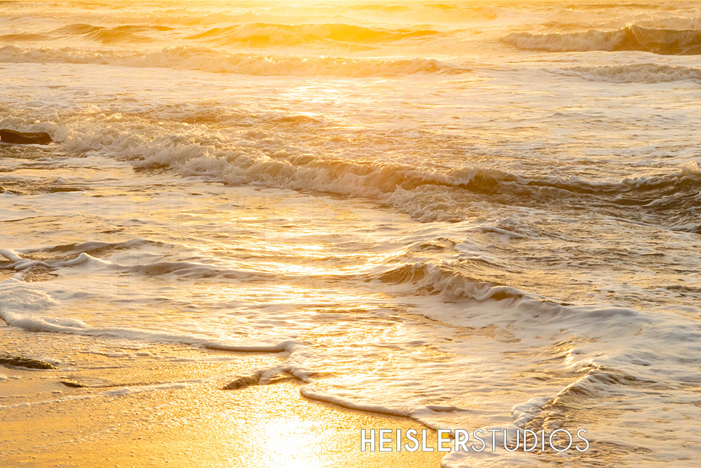 The golden sunrise reflecting off the waves. Taken at Wasghingto