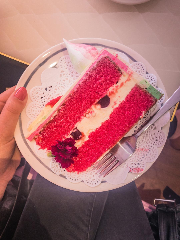 Blong Amsterdam Cafe Woman Holding Cake.JPG