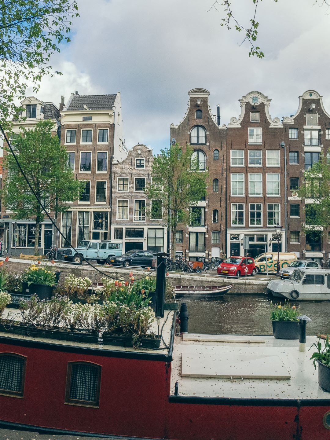 Amsterdam Canal Houses Boat View Close Up.jpg