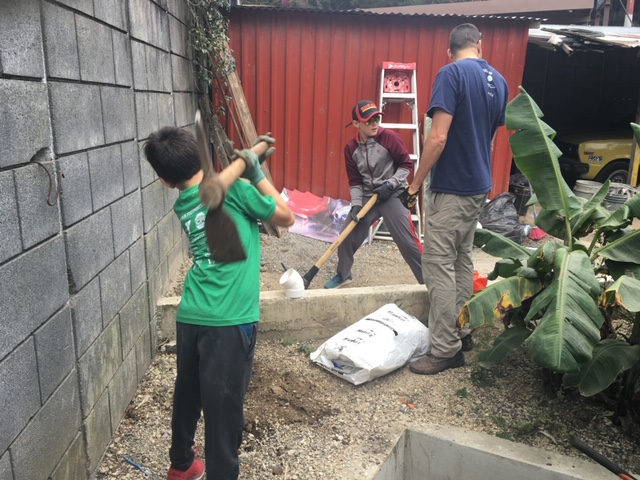 Sammy working hard to help build a trench with Kevin and Ben