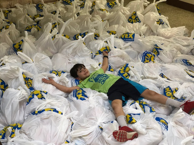 Sammy laying among the 10,000 pounds of food that we measured, bagged and eventually handed out to the people of Jocotillo