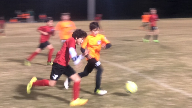 Sammy playing soccer.