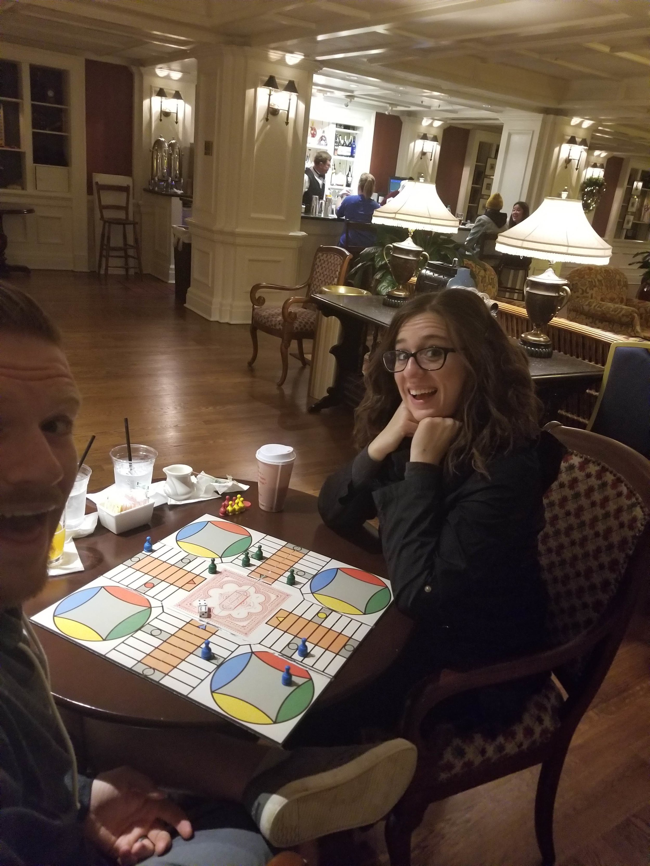 Us playing Parcheesi at the Boardwalk during our scheduled downtime! (which cost us nothing except drinks!)