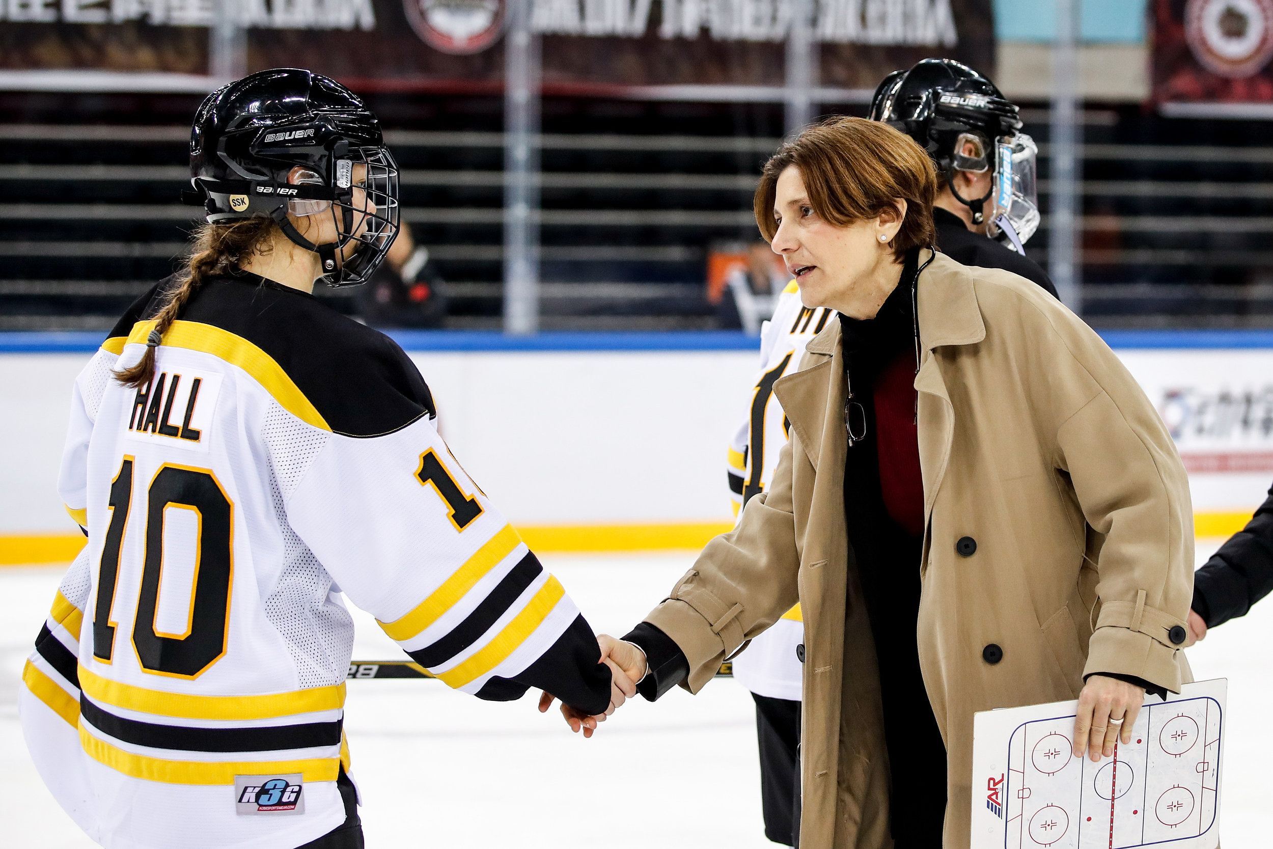Digit shaking hands with Blades player in line.jpg