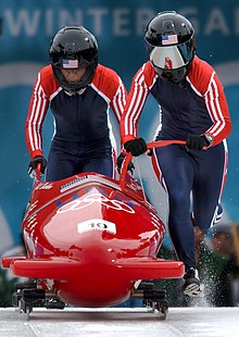 Driver Jill Bakken and Brakewoman Vonetta Flowers push the sled in 2002 -