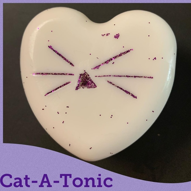 Cat-A-Tonic Soap:  Made with a goat's milk base, Chamomile, Frankincense and Lavender essential oils, and accented with Glitter Whiskers for sparkle.