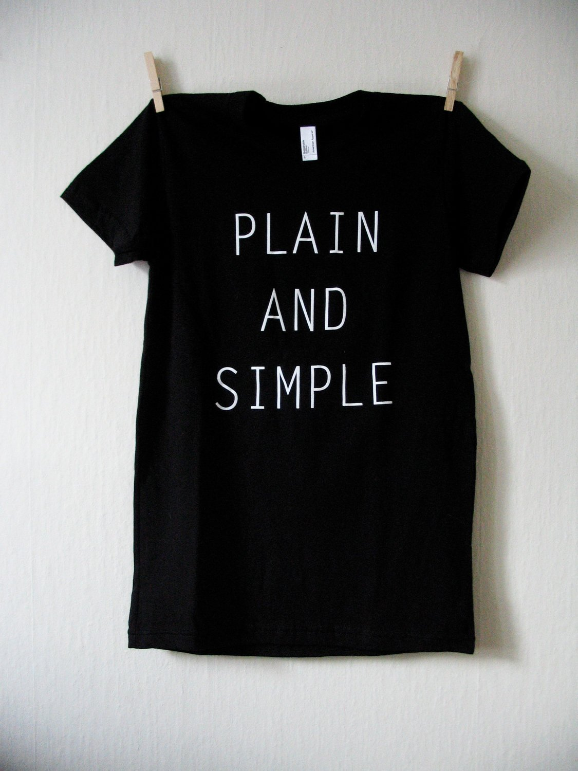 PLAIN AND SIMPLE -  (BACK of Shirt: Contains a small 'Wider Awake' Logo)  $9.00