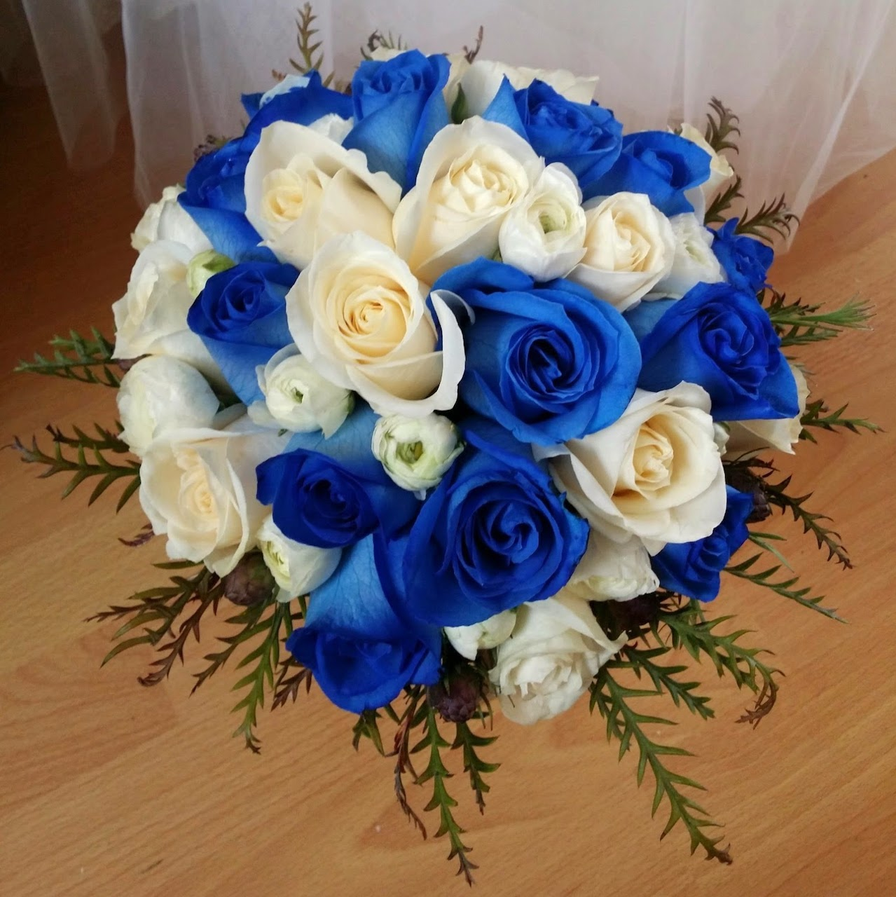 - What better way to add contrast than by having two colors that are nearly opposite of one another? We love how the blue and white compliment each other in a dramatic, yet elegant way in this simple, yet effective wedding bouquet.