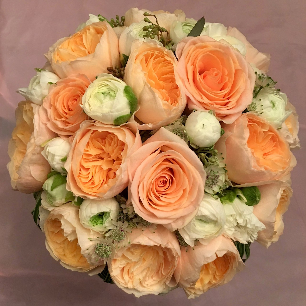 - Peonies and garden roses are like a match made in heaven. They add so much texture to a bouquet, and this wedding bouquet perfectly captures the different stages of these flowers. And who doesn't love peach colored flowers?