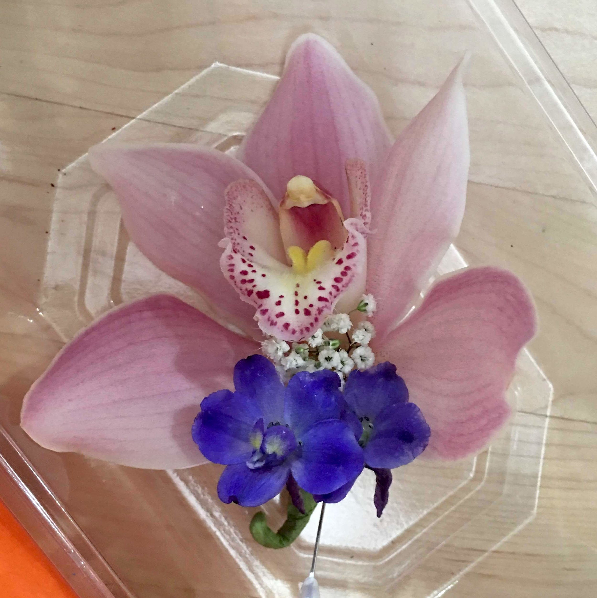 - Orchids are so incredibly beautiful, yet difficult to incorporate into weddings because of how delicate they are. A boutonniere is the perfect place to add an orchid. We added a pop of color to bring attention here as well.