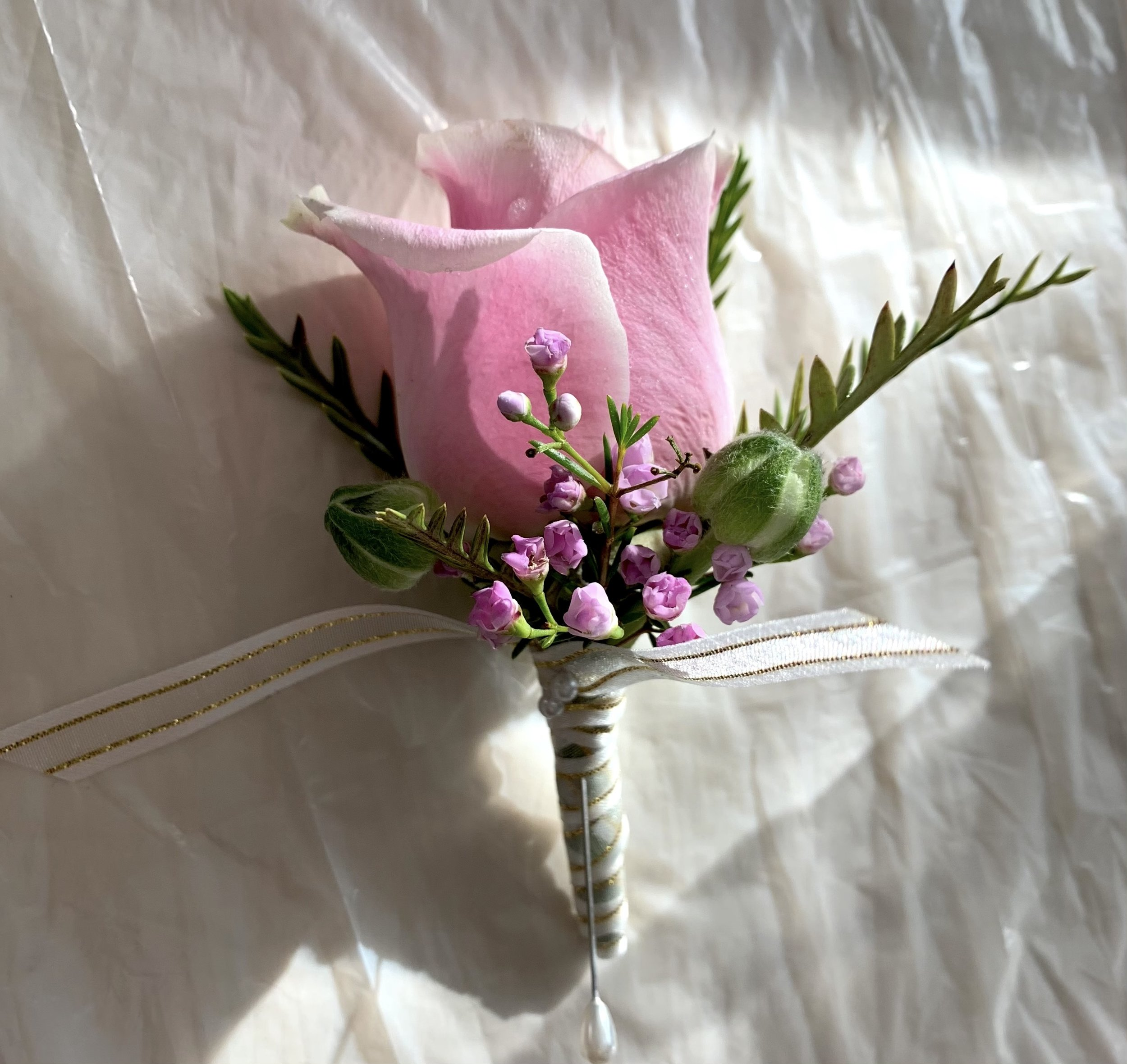 - Sometimes smaller flowers lend themselves well to a simple boutonniere. We wanted to keep this one understated and sophisticated.