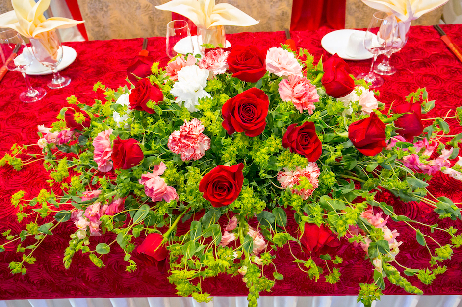 - Red is such a prevalent color for Chinese weddings, so we wanted to create a centerpiece that would stand out and compliment the red tablecloth. The inspiration for this wedding centerpiece was to keep it earthy and bright.
