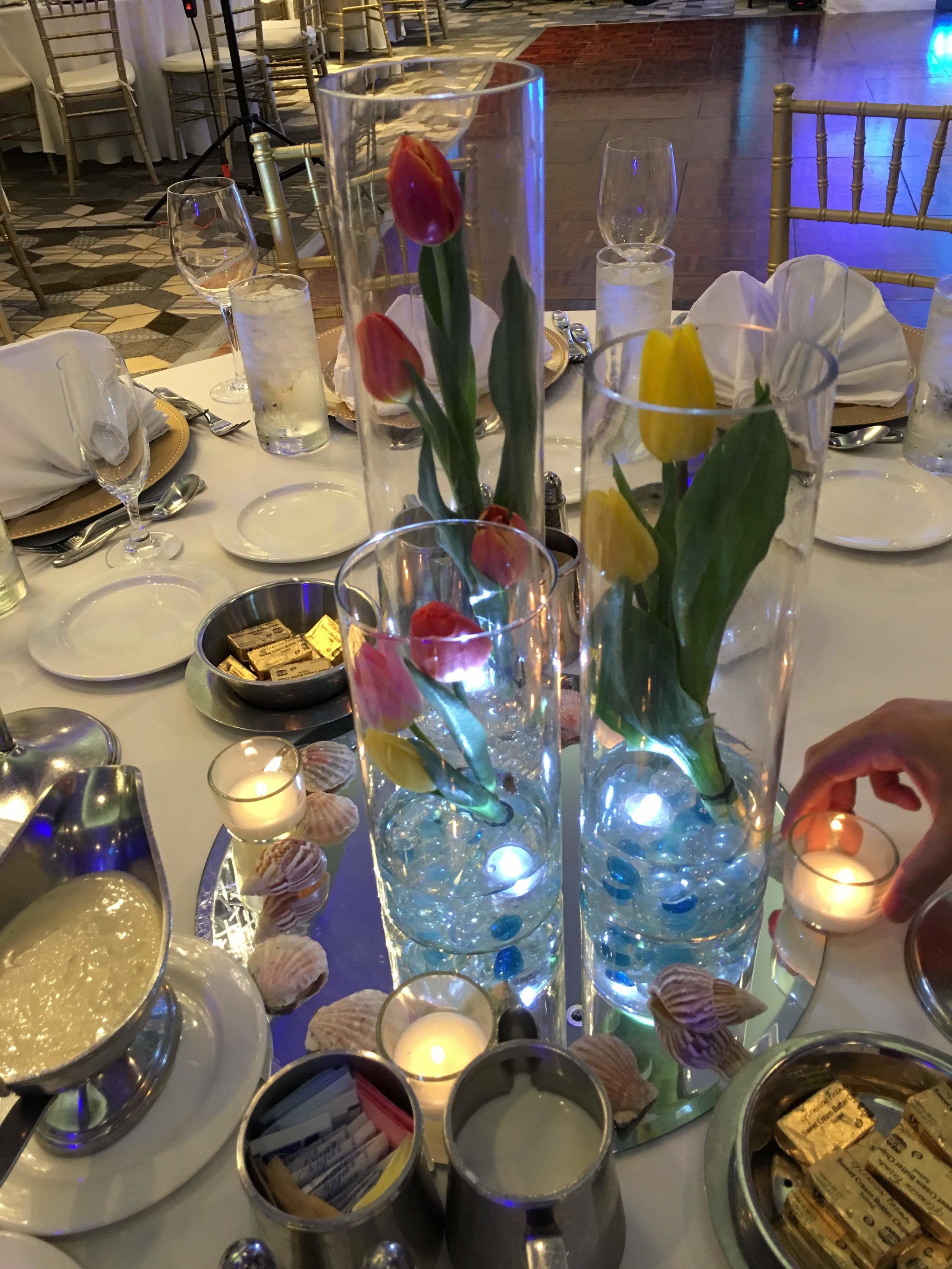 - Another way to create an interesting element to your wedding centerpieces is to create different levels. We love how simple, yet elegant this tulip centerpiece is, and how the different levels creates the idea of waves.