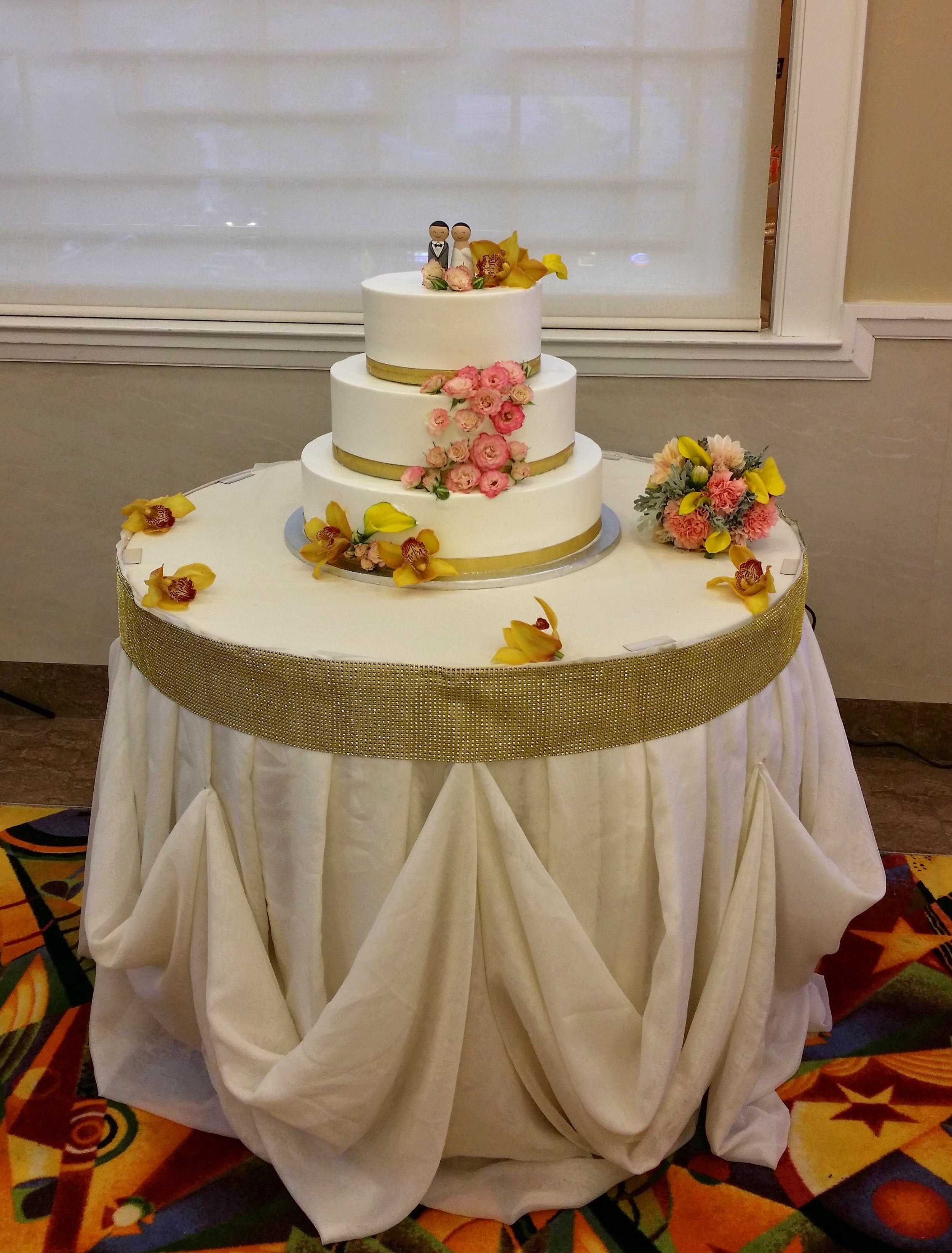 - What better way to bridge together the cake and the table showcasing the cake than by coordinating the colors. Top it off with some simple orchids and we couldn't be more excited how lovely the floral accents lended themselves.