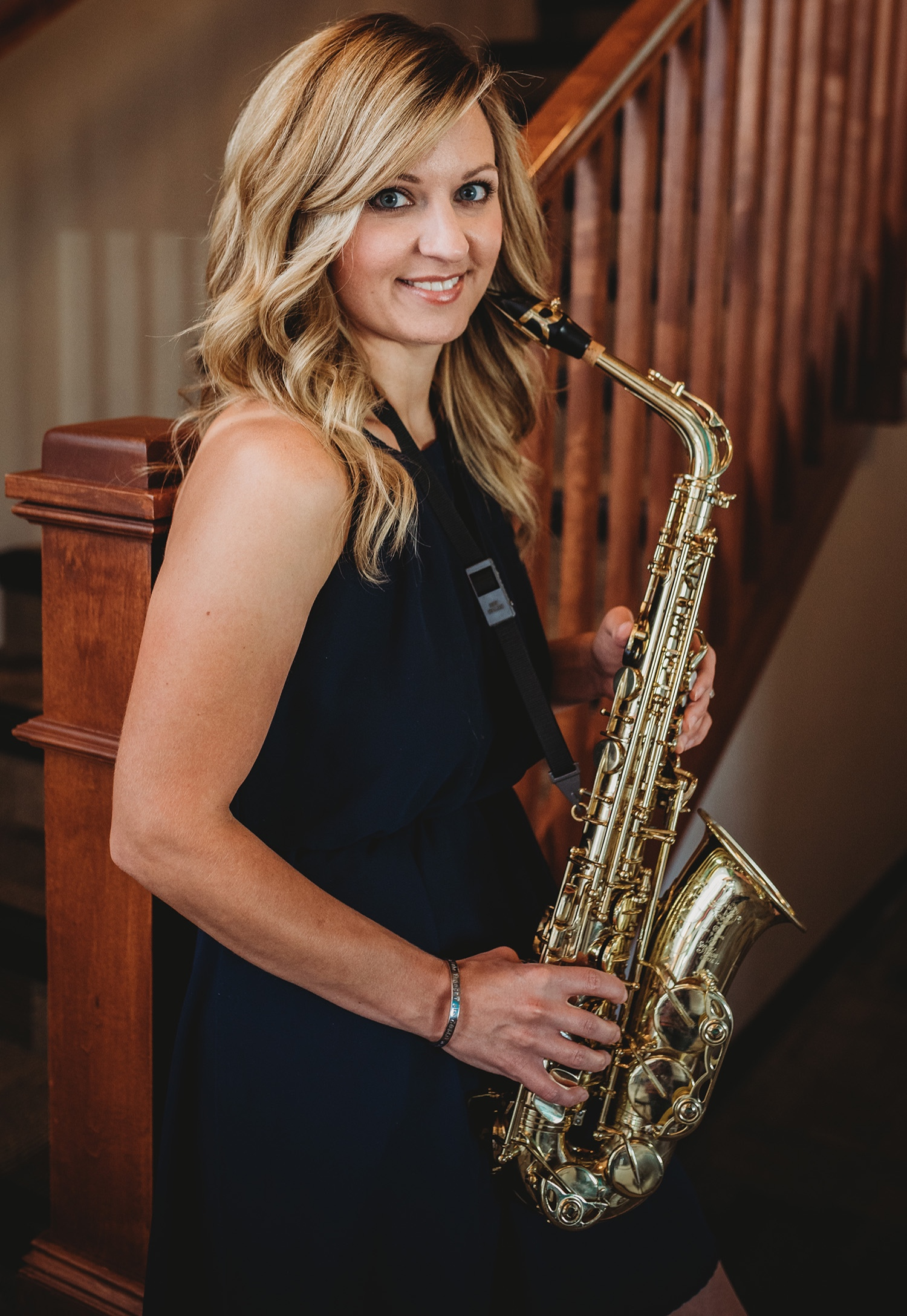 Amy Munsell    Owner & Director   Mrs. Amy Munsell grew up in Cheyenne, Wyoming and the seeds of her love of music were planted early in her youth. She took up the saxophone when she was ten years old and played throughout her public school years. In 2004 after leading the Cheyenne East High School Marching Band as drum major, she left for the University of Wyoming where she earned her Bachelor of Arts in Music Education. During her collegiate career she played her saxophone with many artists and travelled to play in regional quartet and national solo competitions. The highlight of Amy's performances at UW was a victory in the Dorothy Jacoby Concerto Competition as the first saxophonist and the first Music Education major to win.  While teaching in Natrona County School District #1, Amy taught K-6 general music and beginning band at 21 different schools and assisted the high school marching bands. Mrs. Munsell resigned in 2013 to open VIBES Fine & Performing Arts, LLC.  VIBES Fine & Performing Arts has grown to hundreds of students in various lessons and classes since opening. VIBES has served thousands of preschoolers through outreach programs to help serve the community and support children's brain development through music. Additionally, VIBES assists hundreds of children through general music and instrumental programs in Converse County School District #2 and Natrona County School District #1.  Amy leads an Award Winning Maestro Top Program (Top 5% Best Kindermusik Programs Worldwide) and assists in directing over twenty instructors ranging in diverse styles of music.  Through VIBES, Amy is involved in many charitable events and activities that contributes to the community each year. Including working with children of varying disabilities, providing lectures for parenting, preschool, and pediatric centers, volunteering in various educational community events, and advocating for music education. Amy also partners with local nonprofits in support of their programs; supports local benefits with student and instructor performances, and brings in several professional guest performances free of charge to the VIBES members and the public.  Amy is adamant about giving her students many opportunities to perform in the public including recitals, master classes, competing in various competitions at the state and national level, and community performances. Amy has planned large-scale events and collaborations with world class professional musicians to motivate and inspire all in the community. Guest artists have included: The Blue Man Group, Denver Broncos Stampede Drumline, Denver Nuggets Skyline Drumline, University of Wyoming Music Faculty, Geoffrey Castle, Brent Daniels, and more!  In her free time, Amy enjoys spending time with her family, snow skiing, and spending time outdoors.