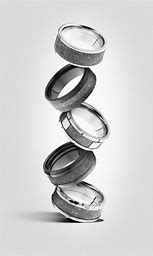Lashbrook, - Custom wedding bands in alternative metals. This American made line is perfect if you are looking for a one of a kind wedding band. With a great product selection and lifetime warranty, it makes it the perfect choice for your special day.