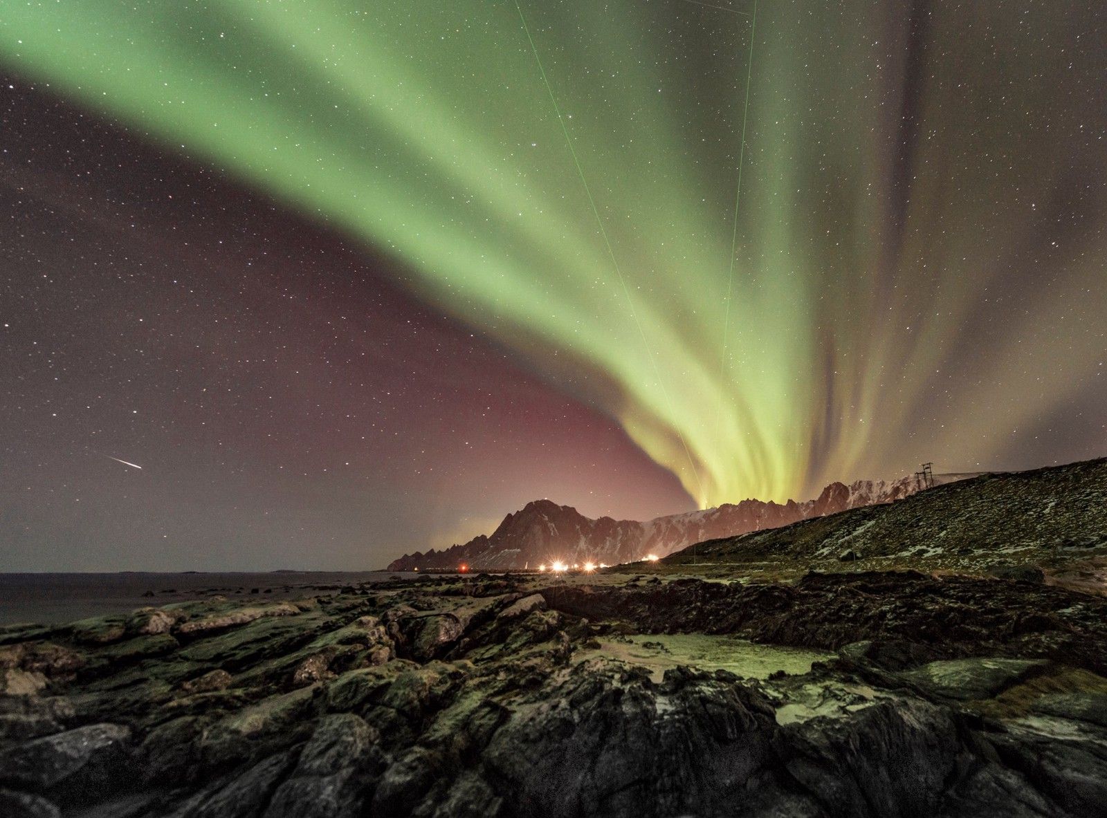Bleik, Andøya, Norway — From the mountain you can see the two lasers from the Alomar Observatory. (Photo © Ola Albert Bjerrang)