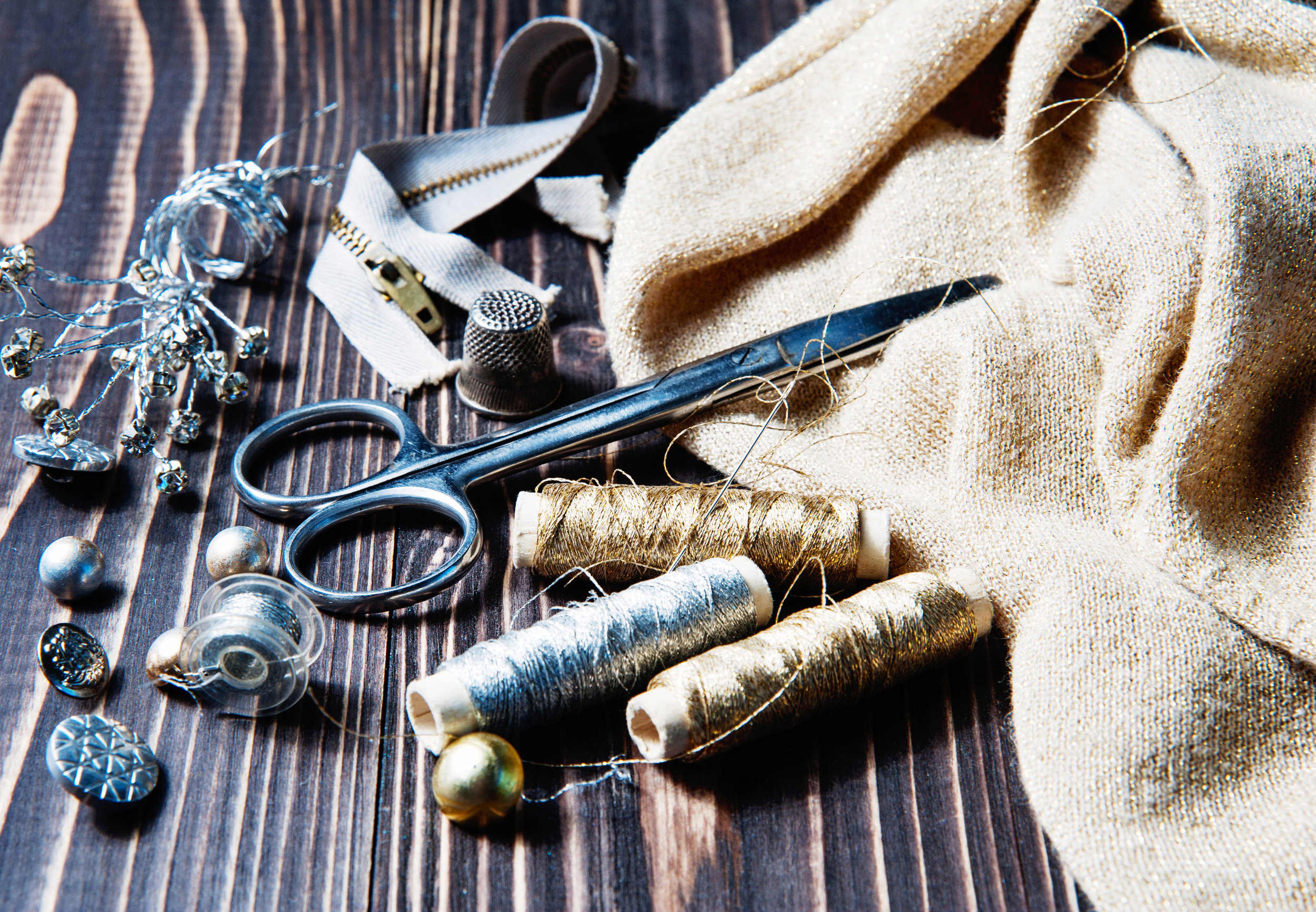 Scissors, cotton reels, thimbles and the tools of an Upholsterer's trade