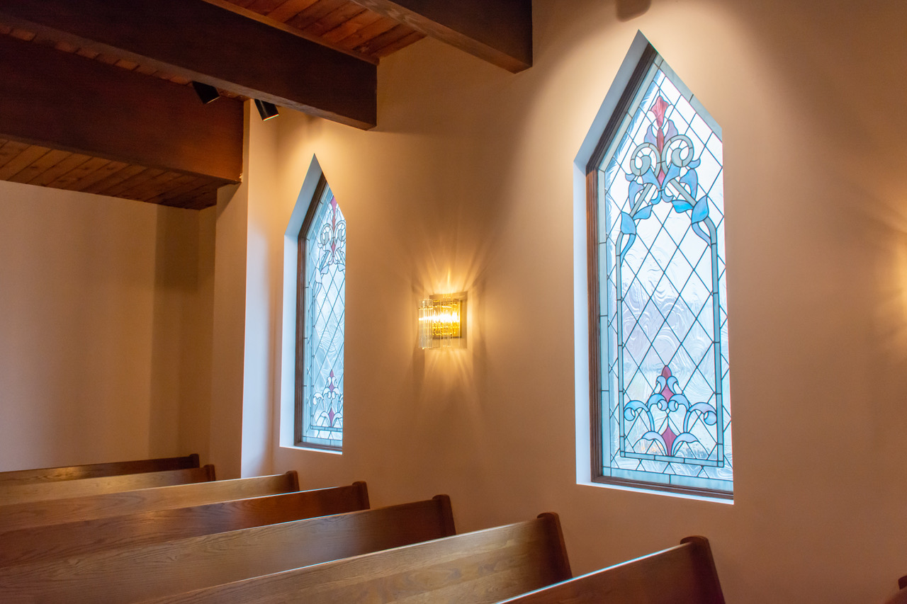 Chapel - Mitchell Funeral Home has a separate, designated chapel space with floor-to-ceiling windows, outside of which is a small garden. This peaceful atmosphere evokes a mood of quiet reflection.