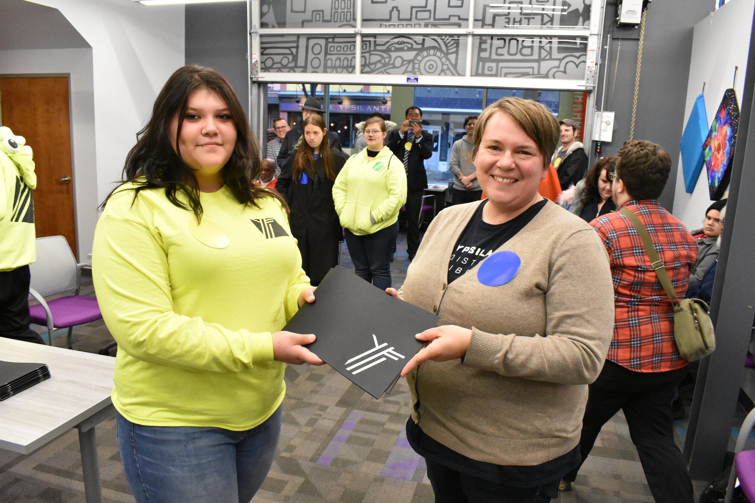YFi presents commemorative book to Ypsilanti District Library