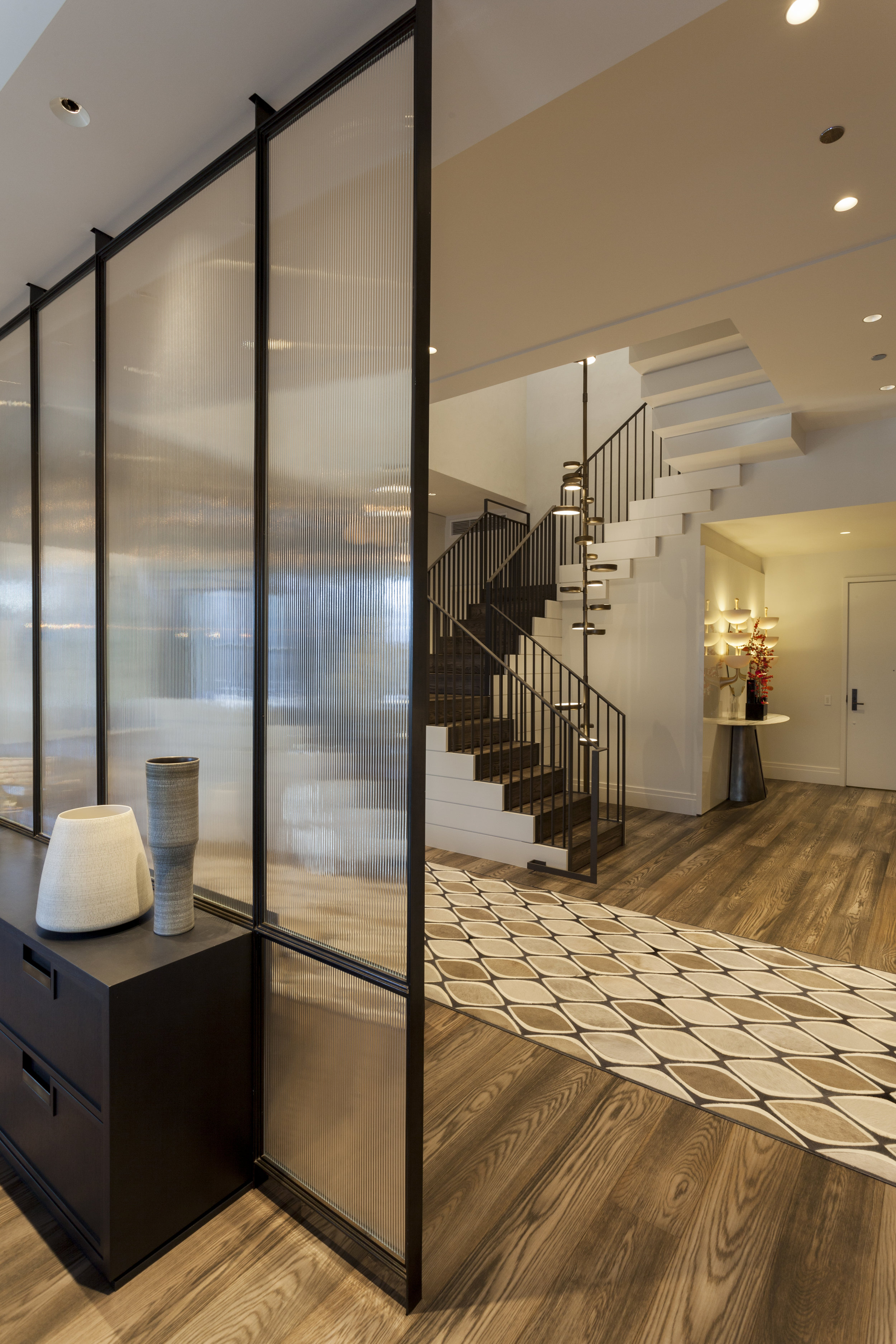 Modern Dining Room with Staircase Beyond in Gold Coast Penthouse