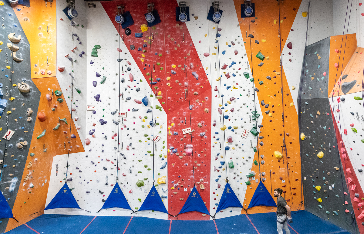 "Autobelays - These devices take up the rope (aka ""slack"") as you climb, allowing you to scale routes without a partner. A special orientation is required to use the autobelays. Please see a Cliffs staff member to get one."